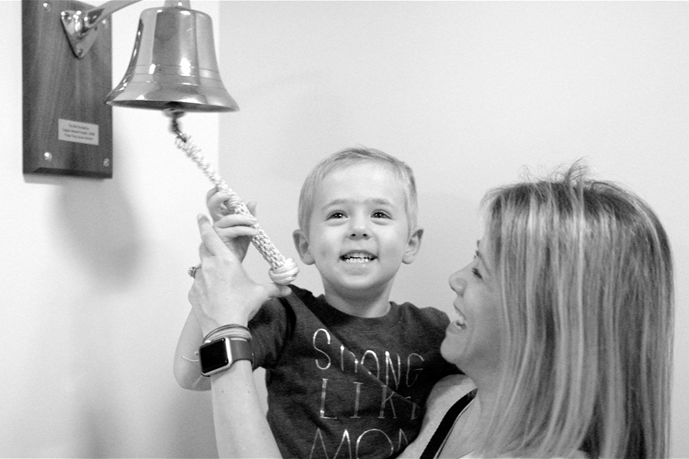 Lindsay and Harrison ring the bell to celebrate her last chemotherapy treatment.